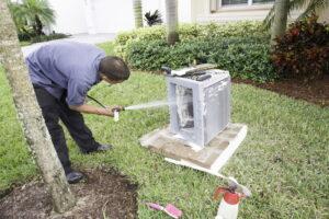 AC-technician-washing-condenser